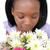 charming young woman smelling flowers stock photo © wavebreak_media