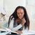 młodych · kobiet · student · piętrze · praca · domowa · pracy - zdjęcia stock © wavebreak_media