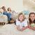 adorable · familia · viendo · tv · salón · alimentos - foto stock © wavebreak_media