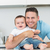 happy father embracing baby stock photo © wavebreak_media