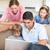 aile · dizüstü · bilgisayar · kullanıyorsanız · oturma · odası · dört · birlikte · bilgisayar - stok fotoğraf © wavebreak_media