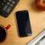 overhead of smartphone with calculator stock photo © wavebreak_media