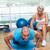 female trainer assisting man with push ups at gym stock photo © wavebreak_media