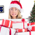 composite image of festive blonde holding pile of gifts stock photo © wavebreak_media
