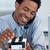 Smiling businessman on phone looking at card holder stock photo © wavebreak_media