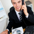 Handsome businessman using phone in office stock photo © wavebreak_media