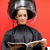Young woman under a hairdressing machine while reading a magazine stock photo © wavebreak_media