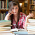 disappointed student having a lot to read in a library stock photo © wavebreak_media