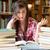 csalódott · diák · olvas · könyvtár · nő · könyv - stock fotó © wavebreak_media