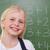 Blonde schoolgirl posing in front of a blackboard stock photo © wavebreak_media
