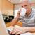 портрет · человека · используя · ноутбук · питьевой · чай · кухне - Сток-фото © wavebreak_media