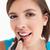 anziehend · lächelnd · Lippenstift · weiß - stock foto © wavebreak_media