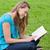 heureux · jeune · fille · lecture · livre · séance · herbe - photo stock © wavebreak_media