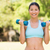 healthy smiling woman exercising with dumbbells in park stock photo © wavebreak_media