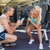 male trainer assisting woman with dumbbell in gym stock photo © wavebreak_media