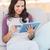 pretty brunette using her tablet stock photo © wavebreak_media