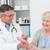 médico · examinar · mano · ortopédico · cirujano · blanco - foto stock © wavebreak_media