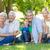 счастливая · семья · улыбаясь · камеры · женщину · дерево - Сток-фото © wavebreak_media