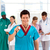 Doctor with colleagues in the background stock photo © wavebreak_media