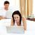 mutlu · genç · aile · dizüstü · bilgisayar · kullanıyorsanız · birlikte · yatak - stok fotoğraf © wavebreak_media