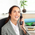 Cheerful hispanic businesswoman talking on phone in front of her laptop in her office sitting at her stock photo © wavebreak_media