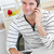 attractive man talking on phone using his laptop in the kitchen at home stock photo © wavebreak_media