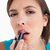 atraente · mulher · jovem · batom · branco - foto stock © wavebreak_media