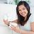笑みを浮かべて · 若い女性 · ギフトボックス · 花 · 休日 · 人 - ストックフォト © wavebreak_media