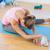 sporty woman stretching hand to leg in fitness studio stock photo © wavebreak_media