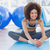Fit woman doing the butterfly stretch in exercise room stock photo © wavebreak_media