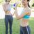 красивой · молодые · Фитнес-женщины · Постоянный · питьевая · вода · белый - Сток-фото © wavebreak_media