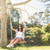 pretty brunette swinging in park stock photo © wavebreak_media