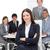 sonriendo · mujer · de · negocios · sesión · equipo · reunión · negocios - foto stock © wavebreak_media