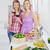 vrouwelijke · vrienden · permanente · keuken · vrouwen · brood - stockfoto © wavebreak_media