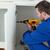 Young handyman fixing a door in a kitchen stock photo © wavebreak_media
