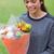 Young smiling girl receiving a beautiful bunch of flowers stock photo © wavebreak_media