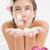 composite image of beautiful happy woman blowing flower petals a stock photo © wavebreak_media