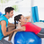 male trainer helping woman with her exercises stock photo © wavebreak_media