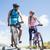 fit cyclist couple taking a break on rocky peak smiling at each stock photo © wavebreak_media
