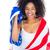 mooie · meisje · Amerikaanse · vlag · glimlachend · camera · witte - stockfoto © wavebreak_media