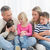 Happy family sitting with pet kitten together stock photo © wavebreak_media