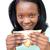 Happy young woman eating a sandwich  stock photo © wavebreak_media