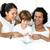 souriant · peu · garçon · lecture · parents · lit - photo stock © wavebreak_media
