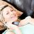 feliz · mujer · control · remoto · sesión · sofá · casa - foto stock © wavebreak_media