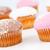 muffinok · porcukor · együtt · fehér · háttér · eszik - stock fotó © wavebreak_media
