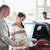 Smiling woman chatting with a car dealer in a car shop stock photo © wavebreak_media