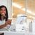 pretty businesswoman reading newspaper at her desk stock photo © wavebreak_media