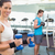 fit brunette exercising with blue dumbbells stock photo © wavebreak_media