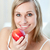 glimlachende · vrouw · eten · appel · home · vrouw · voedsel - stockfoto © wavebreak_media