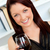 Elegant young woman holding a glass of wine at home looking at the camera stock photo © wavebreak_media